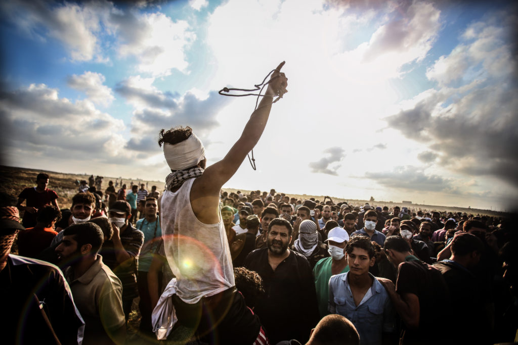 Palestinian demonstrators at the fence separating Gaza and Israel during a protest Picture credit: Yosef Basam